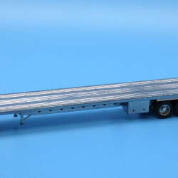 Modern 53t quad axle flatbed trailer with adjustable rear tag axle
